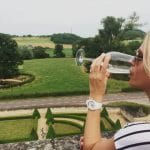 Drinking wine overlooking the baroque gardens at Chateau Neercanne
