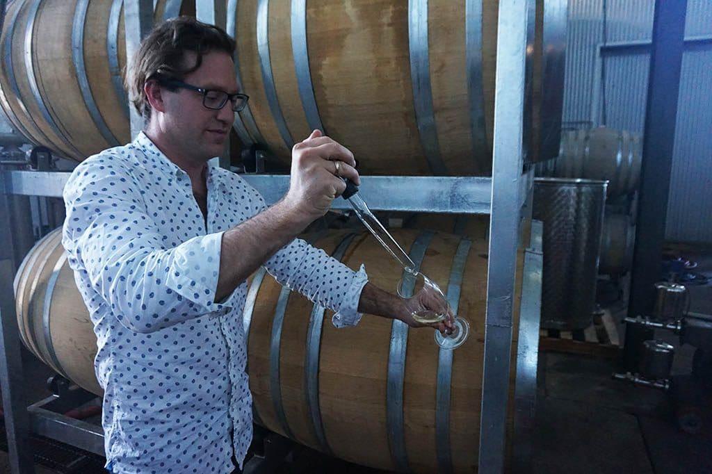 Nick porring wine form the barrel at paring estate