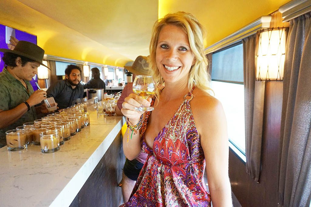 Drinking tequila at the bar during tequila herradura express tour